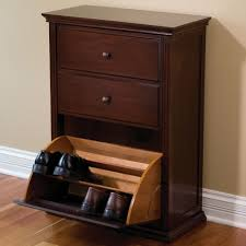 Brown stain wall featuring hideaway shoe cabinet and varnished wood ...