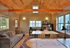 cathedral ceiling decorating ideas home office transitional with brown sofa wood table wood ceiling post