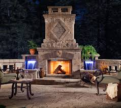 outdoor fireplace with water features and custom masonry