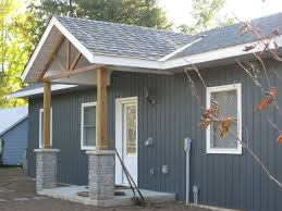 lake side cottage finished with midnight surf board and batten siding work done by lakeridge design and construction