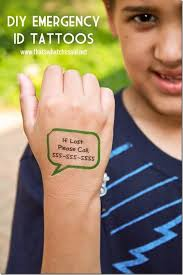 child wearing safety custom temporary tattoo with phone number to call in case of separation