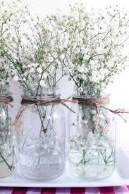 Mason Jars Decorated With Twine Mason jar twine baby's breath and tree stump as centerpiece 78