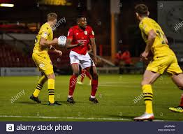 CREWE, ENGLAND - NOVEMBER 23RD Steven Old of Morecambe fc and Chuma Anene  of Crewe Alexandra looking for the ball during the Sky Bet League 2 match  between Crewe Alexandra and Morecambe