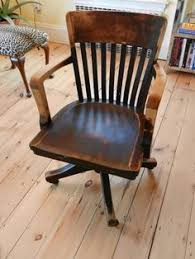 antique wooden office chair. items similar to old vintage wooden industrial or office desk armchair with casters on etsy antique chair l