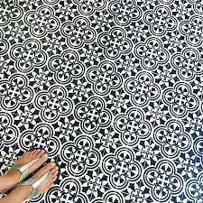 a creative fan stenciled this old floor using the augusta tile stencil pattern in black and white design from cutting edge stencils white stencils l78 stencils