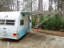 on to the awning now this is another one of those things we didn t stick to tradition on usually the vintage travel trailers have rope and pole awnings