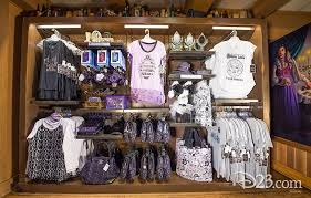 photo of merchandise in including madame leota themed tee shirts jerseys purses