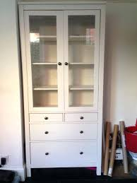 compact hemnes glass door cabinet that eye cathcing in combination assembly