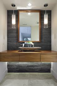 walnut bathroom vanity modern ridge: a modern bathroom with natural stone accent wall and pendant lights under bench lighting