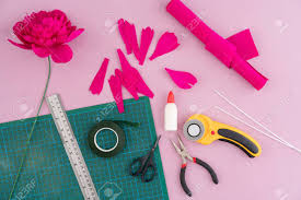 Paper Flower Cutting Tools Utensils And Tools For Making Crepe Paper Flowers On Pink Wooden