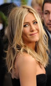 jennifer aniston always has the perfect beachy blonde highlights in her naturally brown hair