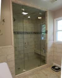 traditional bathroom with frameless glass shower doors and window