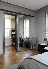 a sliding barn door mirror love this and it almost makes the room behind seem secret with the door closed