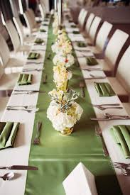 Chic green table runner and floral arrangements. Photo by Kevin Paul  Photography. www.