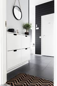 Black & white foyer and I recognize the shoe storage cabinet by Ikea.  Simple &