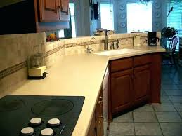 corian countertops home depot cost s vs granite quartz long wooden kitchen island with grey