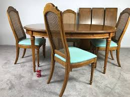 esperanto by drexel formal dining table with 3 leaves and 4 cane back chairs photo