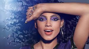 covers original image of a model wearing baltimore ravens inspired makeup