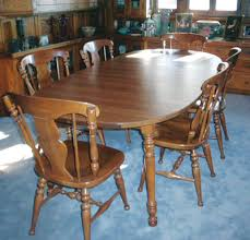 This table while it seems to match the HeywoodWakefield chairs and hutch