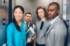 people inside elevator. multiracial business team in elevator stock photo people inside a