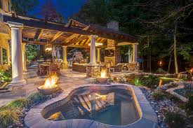 koi pond lighting ideas. Stone Patio With Outdoor Kitchen Hot Tub And Koi Pond Jason Cromley HGTV Lighting Ideas