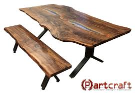 picture of custom live edge walnut slab dining set with leds glass inlay