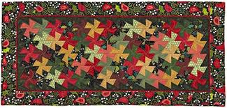 Christmas Lil' Twister Quilt Kit designed by Becky Cogan for Need ... & Our Price: $48.00 Adamdwight.com