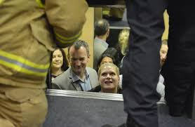 people stuck in elevator. libby shepherd talks to firefighters as they work free nine people trapped in an elevator stuck