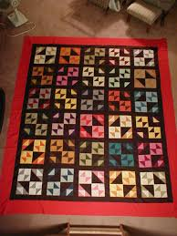 That man Quilts?: Men Quilt, two & Here it is after quilting. I quilted a quarter inch inside of each piece  with a black thread. And, in the outer border, straight lines at 1