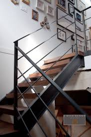 Industrial Loft Stair Hall - Architect Ryan Duffey removed the existing  narrow spiral staircase and created. Railings For StairsIron ...