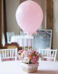 Pink flower pot and balloons centerpiece