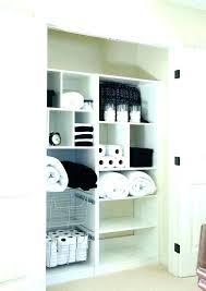 linen closet door bathroom ideas contemporary pertaining to doors cupboard rack