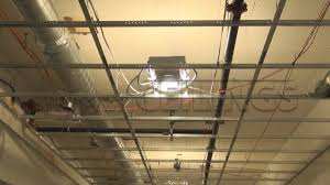 drop ceiling track lighting installation. light fixtures installing in a drywall suspended ceiling grid drop track lighting installation