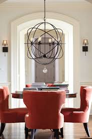 lighting a room. A Dramatic Light Fixture Creates A Focal Point In Room Lighting