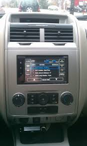 Radio Repairs   including Blank Radio Display  Ford   Nissan Quest likewise Ford C max   Focus 2011 remove radio cd player   YouTube as well  besides MyFord Touch   Wikipedia further  moreover 2014 Ford Escape Reviews and Rating   Motor Trend as well  together with  in addition How to listen and reply to text messages with SYNC   SYNC further How to install a stereo   speakers in a 2008 2012 Ford Escape additionally Ford Escape Dimensions   2018 2019 Car Release and Reviews. on 2011 ford escape radio display information