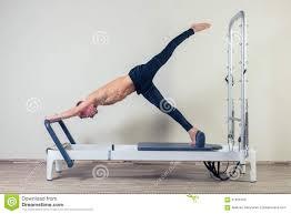 pilates reformer workout exercises man at gym royalty free stock photo