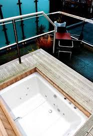 the xanadu japanese style soaking tub shown outdoor on a terrace