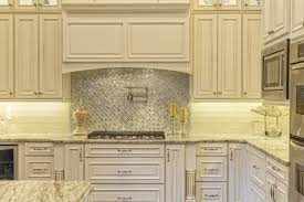 a custom quirky and unique backsplash is one of the most on trend ways to update a kitchen and personalized tiles are an innovative option to truly get a