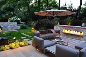 cozy sitting area with outdoor fireplace