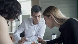nice person office. Business Meeting Of Women Man Sitting At Table Inside Office. Nice Blonde Woman With Straight Hair, Black Shirt Writes Notes About Ideas, Person Office