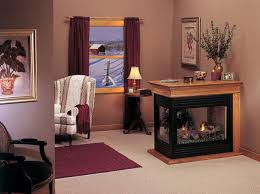new black peninsula designer fireplace with glass surrounding was installed by henges in olathe ks