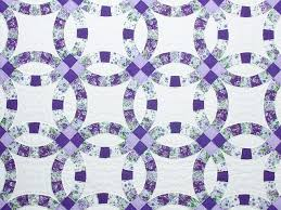 Double Wedding Ring Quilt -- gorgeous skillfully made Amish Quilts ... & ... Lavender and Green Double Wedding Ring Quilt Photo 3 ... Adamdwight.com