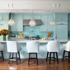 transitional kitchen lighting. transitional blue open plan kitchen with barstools lighting k
