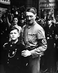 hitler he s always creepy around kids ww nazi dictator adolf hitler poses a young member of one of the nazi youth organisations