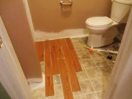 installing vinyl wood plank flooring in small spaces bathroom remodel ideas