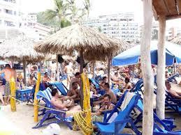 blue chair puerto vallarta. the puerto vallarta gay beach - blue chairs during easter week or semana santa. chair