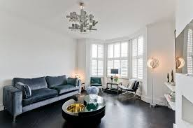 furnitures simple living room with dark grey sofa and exquisite black coffee table under unique