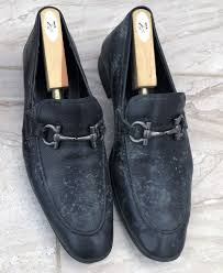 black loafers with shoe trees before treatment