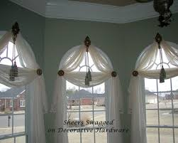 Arched Window Treatments--I like this, but will block chandelier from the  road