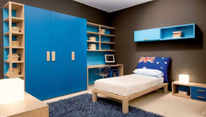 Adorable Bedroom Cupboards Design With Dark Black Wall Paint And Cream  Flooring And Blue Fur Area